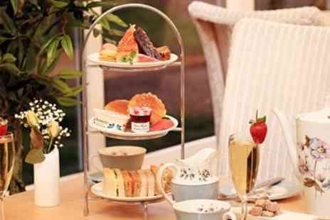 Surya Hotels - Afternoon tea & bubbly for 2 in Farnham - Save 37%