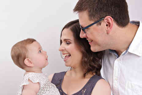 Xposure Studios - Family photoshoot for up to eight people including refreshments, one 8 Inch x 10 Inch print, two 7 Inch x 5 Inch prints and £100 of vouchers towards additional images - Save 89%