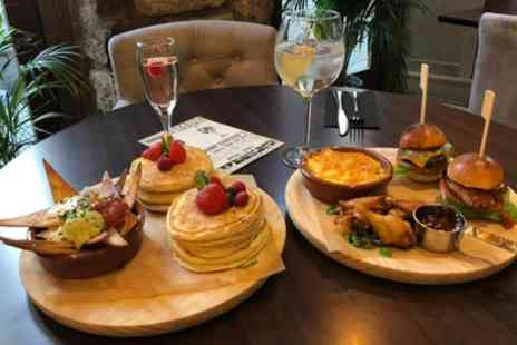 Roosevelts Bar and Kitchen - New York Style Afternoon Tea with Choice of Spritz Cocktail for Two or Four - Save 54%