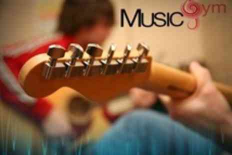 Music Gym - Guitar or Singing Lessons for Four One to One Sessions - Save 58%