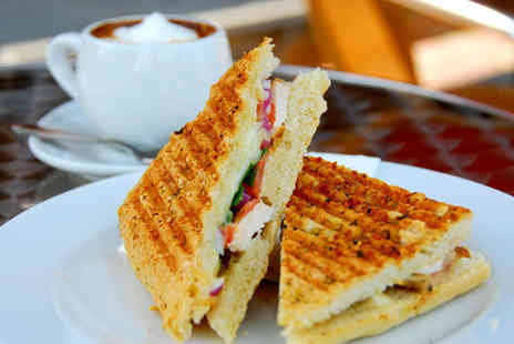 Coffee Republic - Two freshly made paninis or sandwiches plus two packets of crisps and two coffees or teas - Save 62%