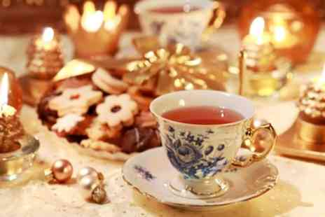 Southwell Garden Centre - Festive Afternoon Tea with Optional Santas Grotto and Gift for Two or Four - Save 42%