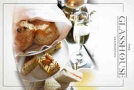 The Glasshouse - Afternoon Tea With a Twist Including Champagne Cocktail For Four - Save 30%