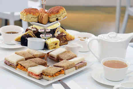 Long Island Coffee Company - Traditional afternoon tea for two people at Full of Beans - Save 51%