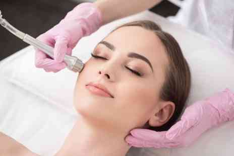 Ultim8Skn - Up to Three Facial Microdermabrasion Sessions - Save 75%