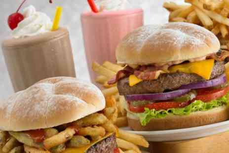 JJs Desi Kitchen - Two Slider Burgers Each and Milkshake for Two or Four - Save 59%