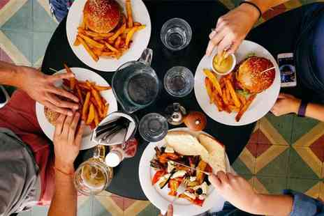 Ambience - Burger and bottle of beer each for two people - Save 50%