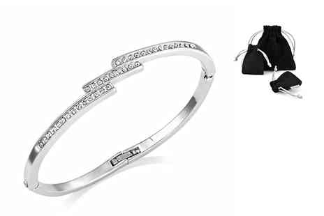 Philip Jones - Tiple row bangle made with crystals from Swarovski - Save 80%
