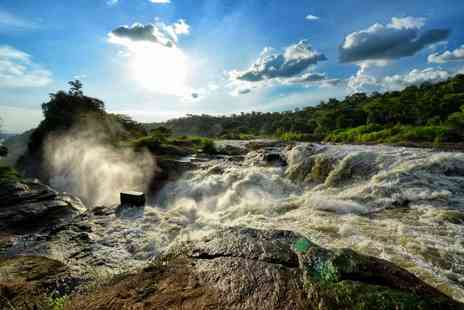 Le Monde Safaris - Four nights full board Ugandan safari with trip to Murchison Falls, visit to rhino sanctuary, game drive and boat cruise - Save 21%