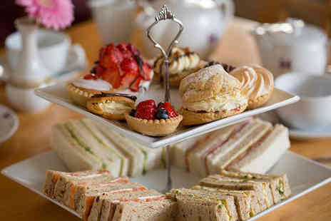 Holiday Inn - Afternoon tea for two people with a glass of Prosecco each - Save 50%