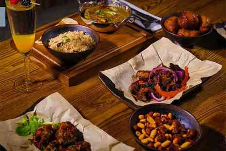Parliament Bar and Kitchen - Four tapas to share for two people with a cocktail each - Save 39%