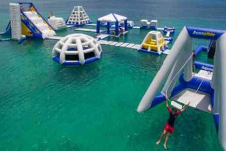 Aqua Bounce - One Hour Water Park Session with Wetsuit Hire for Up to Four - Save 25%