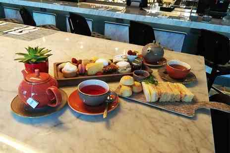 Clayton Hotel - Afternoon tea for two people with two teapots of gin and tonic to share and free flowing tea - Save 50%