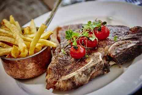 Marco Pierre White Steakhouse Bar & Grill - Two course lunch for two people or Two course dinner with a glass of wine each - Save 45%