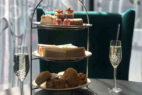 Marco Pierre White Steakhouse - Luxury afternoon tea for two people with a Bellini or glass of Prosecco each - Save 58%