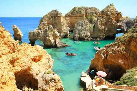 Super Escapes Travel - Three nights half board Algarve beach break with return flights - Save 28%