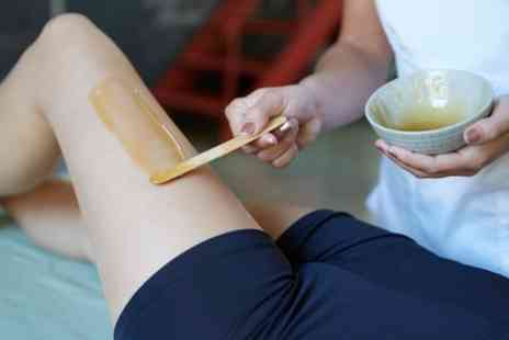 Home of Waxing - Brazilian or Hollywood Hot Wax with Optional Underarms - Save 66%