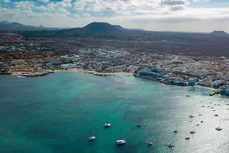 Super Escapes Travel - All inclusive three nights Fuerteventura beach holiday with flights or five nights - Save 29%