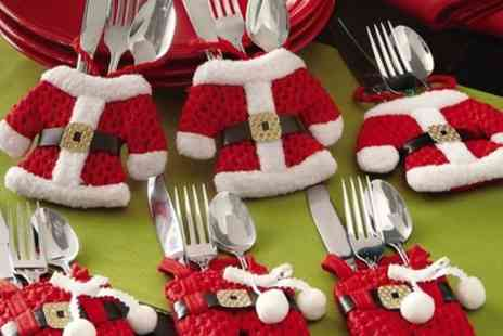 Groupon Goods Global GmbH - 4, 8, 12 or 16 Santa Claus Cutlery Holder Socks - Save 80%