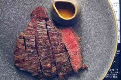 The Carnivore - Steak Meal with Side and Glass of Wine for Two or Four - Save 54%