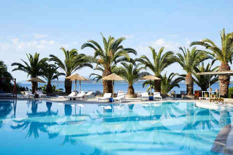 Super Escapes Travel - Seven nights half board Halkidiki holiday with return flights - Save 22%
