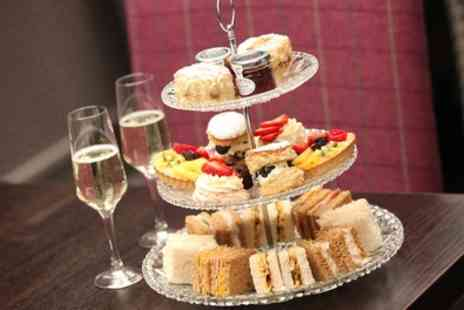 St James Hotel - Afternoon Tea with Optional Glass of Wine for Two or Four - Save 55%